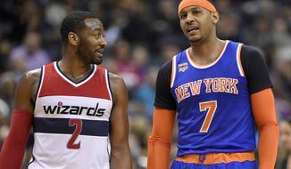 Washington Wizards guard John Wall (2) talks with New York Knicks forward Carmelo Anthony (7) during the first half of an NBA basketball game, Tuesday, Jan. 31, 2017, in Washington. (AP Photo/Nick Wass)