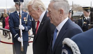 FILE - In this Jan. 27, 2017, file photo, U.S. Defense Secretary Jim Mattis, right, and U.S. President Donald Trump walk into the Pentagon in Washington. Mattis is making his debut with a visit to staunch U.S. allies South Korea and Japan, both of which host tens of thousands of American troops and, for good reason, see North Korea as their biggest national security threat. (AP Photo/Susan Walsh, File)