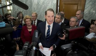 Sen. Ron Wyden, D-Ore., ranking member of the Senate Finance Committee, center, accompanied by, from left, Sen. Debbie Stabenow, D-Mich., Sen. Bill Nelson, D-Fla., Sen. Sherrod Brown, D-Ohio, Sen. Robert Menendez, D-N.Y. and Sen. Bob Casey, D-Pa., speaks in the hallway on Capitol Hill in Washington, Tuesday, Jan. 31, 2017, to discuss opposition to Human Services Secretary-designate, Rep. Tom Price, R-Ga. (AP Photo/Andrew Harnik) **FILE**