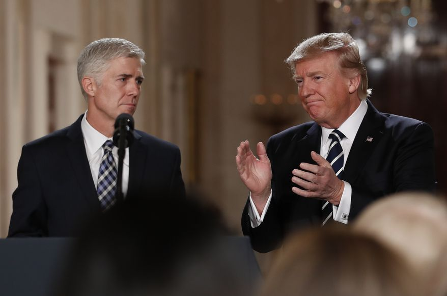 President Donald Trump applauds as he stands with Judge Neil Gorsuch in East Room of the White House in Washington, Tuesday, Jan. 31, 2017, after announcing Gorsuch as his nominee for the Supreme Court. (AP Photo/Carolyn Kaster)