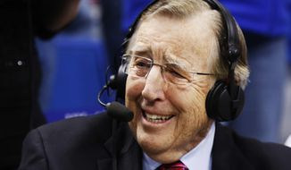 Veteran broadcaster Brent Musburger prepares for his last broadcast prior to an NCAA college basketball game between Kentucky and Georgia, Tuesday, Jan. 31, 2017, in Lexington, Ky. The game marks Musburger's last broadcast before retirement. (AP Photo/James Crisp)