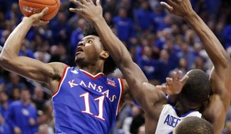 """FILE - In this Jan. 28, 2017, file photo, Kansas' Josh Jackson (11) shoots while defended by Kentucky's Edrice """"Bam"""" Adebayo during the second half of an NCAA college basketball game in Lexington, Ky. Kansas has weathered plenty of off-the-court distractions, enough to beat Kentucky on the road over the weekend. But can the No. 3 Jayhawks keep it going when second-ranked Baylor heads to town on Wednesday night? (AP Photo/James Crisp, File)"""