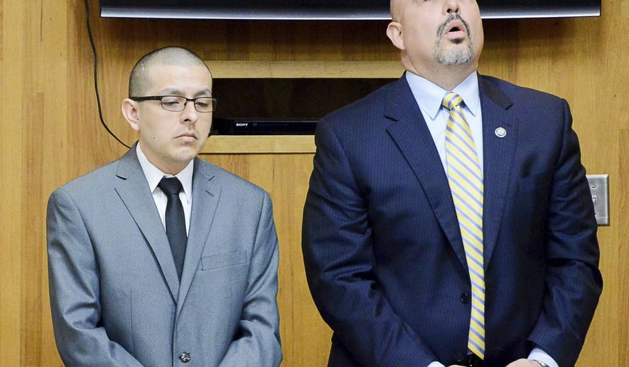 Attorney Carlos Garcia, right, reacts to the reading of a not guilty verdict on murder charges against his client, former U.S. Border Patrol agent Joel Luna, on Tuesday, Jan. 31, 2017, in the 107th state District Courtroom in Brownsville, Texas.  Luna was found guilty on charges of engaging in organized criminal activity while his brother Eduardo Luna  was found guilty of all charges, sentenced to life without parole.  (Jason Hoekema/The Brownsville Herald via AP)