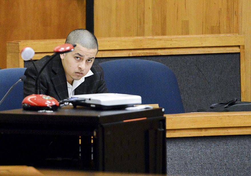 Eduardo Luna sits in the courtroom after being found guilty on capital murder charges, Tuesday, Jan. 31, 2017, in the 107th state District Courtroom in Brownsville, Texas. Luna, was convicted of capital murder for retaliation, murder and two counts of engaging in organized criminal activity and sentenced to mandatory life in prison without parole.  (Jason Hoekema/The Brownsville Herald via AP)