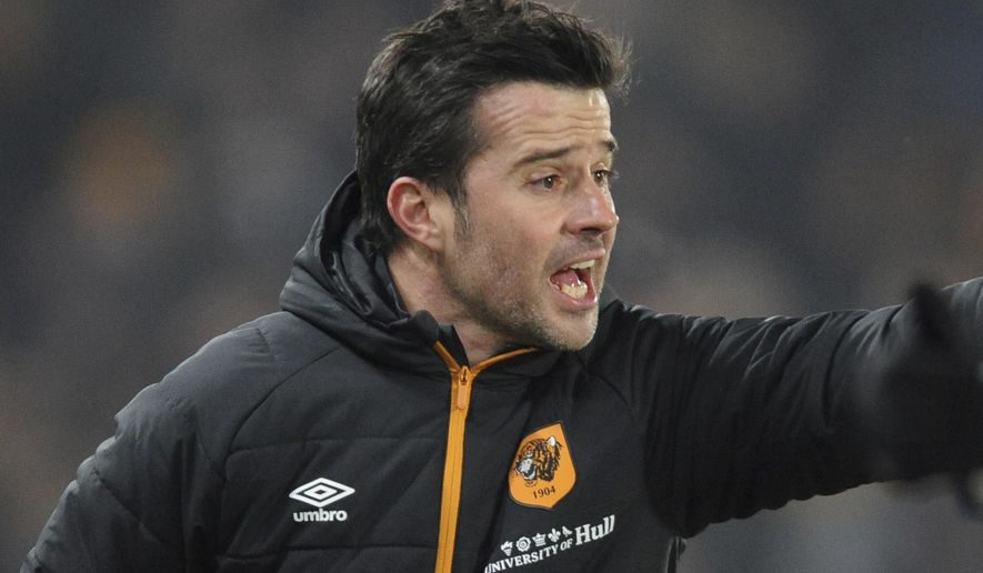 Hull City manager Marco Silva gestures during the English League Cup, Semi Final Second Leg soccer match between Hull City and Manchester United at KCOM stadium in Hull, England, Thursday Jan. 26, 2017. (AP Photo/Rui Vieira)