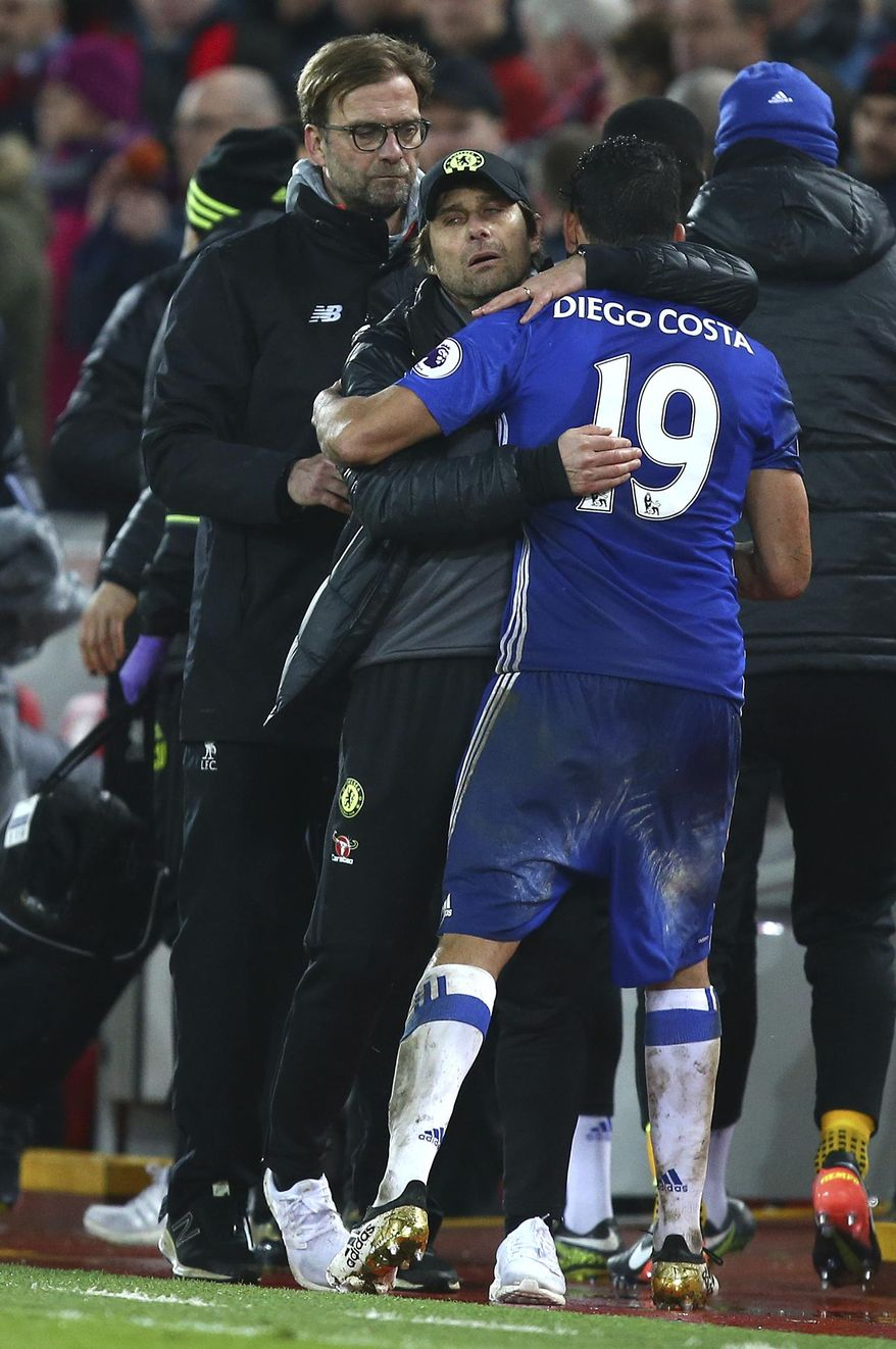 Chelsea's manager Antonio Conte hugs Chelsea's Diego Costa after the English Premier League soccer match between Liverpool and Chelsea at Anfield stadium in Liverpool, England, Tuesday, Jan. 31, 2017. (AP Photo/Dave Thompson)