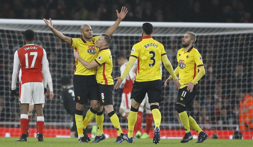 Watford's Younes Kaboul,second left, celebrates after scoring during the English Premier League soccer match between Arsenal and Watford at the Emirates stadium in London, Tuesday, Jan. 31, 2017. (AP Photo/Frank Augstein)