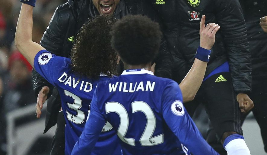 Chelsea's David Luiz, front left, celebrates scoring a goal with Chelsea's manager Antonio Conte and players during the English Premier League soccer match between Liverpool and Chelsea at Anfield stadium in Liverpool, England, Tuesday, Jan. 31, 2017. (AP Photo/Dave Thompson)