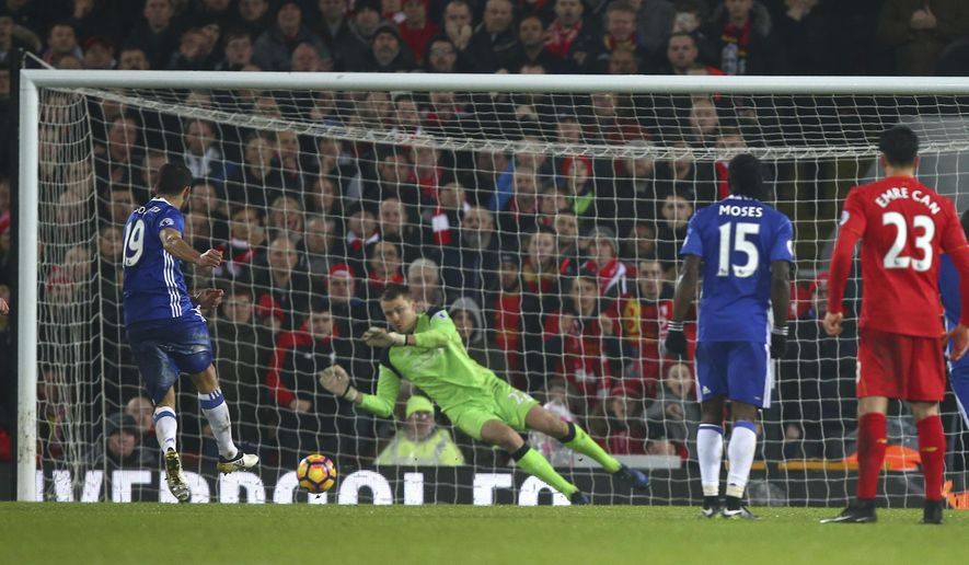 Chelsea's Diego Costa, left, has a penalty shot saved by Liverpool's goalkeeper Simon Mignolet during the English Premier League soccer match between Liverpool and Chelsea at Anfield stadium in Liverpool, England, Tuesday, Jan. 31, 2017. (AP Photo/Dave Thompson)