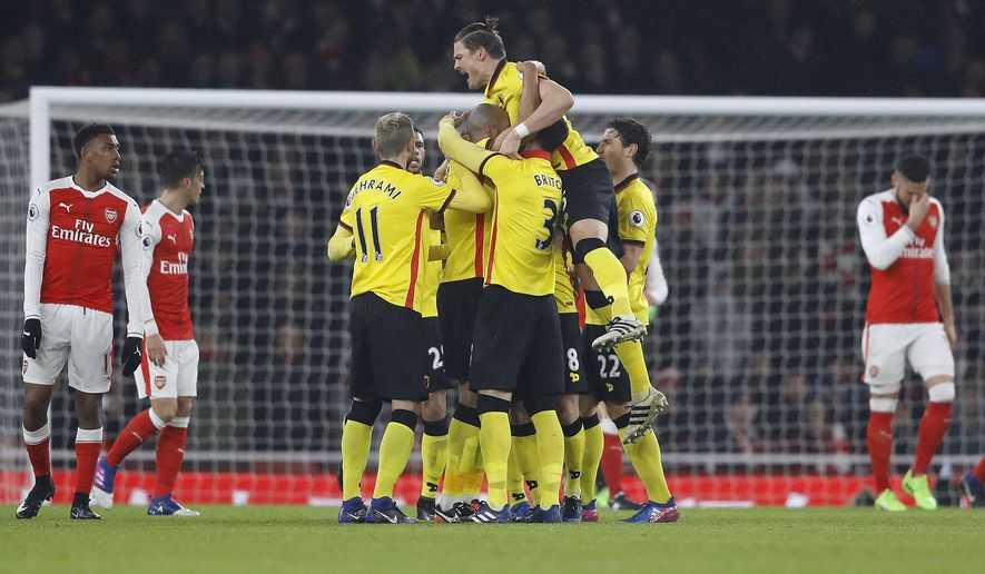 Watford's teammates celebrate after scoring during the English Premier League soccer match between Arsenal and Watford at the Emirates stadium in London, Tuesday, Jan. 31, 2017.(AP Photo/Frank Augstein)