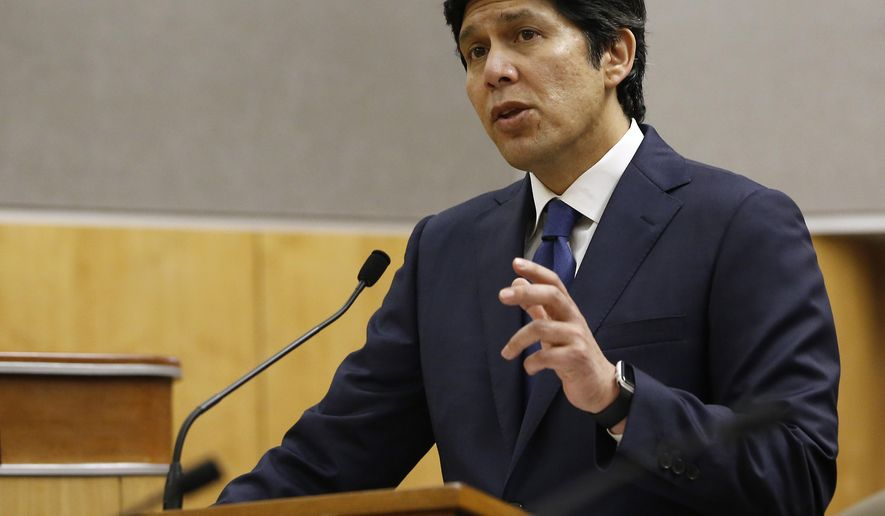 State Sen. President Pro Tem Kevin de Leon, D-Los Angeles, responds to a lawmakers question concerning his bill to prohibit local law enforcement from cooperating with federal immigration authorities during a hearing of the Senate Public Safety Committee, Tuesday, Jan. 31, 2017, in Sacramento, Calif. The committee approved De Leon's measure, SB54, that has been introduced less than a week after President Donald Trump's signed an order threatening to withdraw some federal grants from jurisdictions that bar official from communicating with federal authorities about someone's immigration status. If approved by the Legislature and signed by the governor, it could create a border-to-border sanctuary in the nation's largest state.(AP Photo/Rich Pedroncelli)