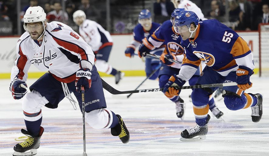 New York Islanders' Johnny Boychuk (55) chases Washington Capitals' Alex Ovechkin (8), of Russia, during the first period of an NHL hockey game, Tuesday, Jan. 31, 2017, in New York. (AP Photo/Frank Franklin II)