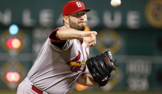 FILE - In this Sept. 28, 2015, file photo, St. Louis Cardinals starting pitcher Lance Lynn (31) warms up before the first inning of a baseball game against the Pittsburgh Pirates in Pittsburgh. After a watching its team ERA balloon from a National-League best 2.94 in 2015 to 4.08 last season, St. Louis knows its starting rotation must improve this year if they hope to catch the Chicago Cubs. The Cardinals believe they have the arms to do that, thanks to the return of a healthy Lance Lynn, a rejuvenated Michael Wacha and a full season from promising rookie Alex Reyes.   (AP Photo/Gene J. Puskar, File)