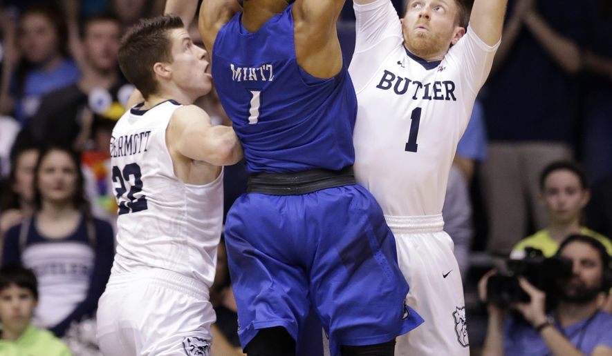 Creighton guard Davion Mintz (1) shoots over Butler guard Sean McDermott (22) and guard Tyler Lewis (1) during the first half of an NCAA college basketball game in Indianapolis, Tuesday, Jan. 31, 2017. (AP Photo/Michael Conroy)