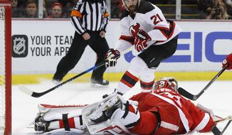 New Jersey Devils right wing Kyle Palmieri (21) scores on Detroit Red Wings goalie Jared Coreau (31) in the first period of an NHL hockey game Tuesday, Jan. 31, 2017, in Detroit. (AP Photo/Paul Sancya)