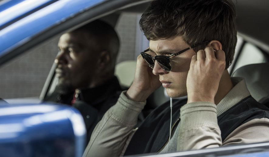 """This image released by Sony Pictures shows Ansel Elgort, right, and Jamie Foxx in a scene from """"Baby Driver."""" The 24th South by Southwest film festival announced it will premiere the film by writer-director Edgar Wright at the festival running March 10-19 in Austin. (Wilson Webb/Sony/TriStar Pictures via AP)"""