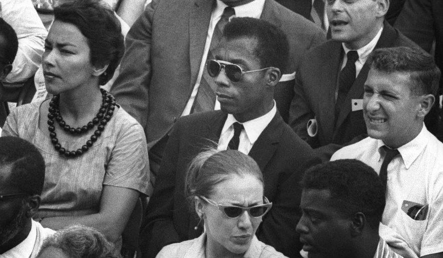 "This image released by Magnolia Pictures shows James Baldwin, center, in ""I Am Not Your Negro."" (Dan Budnik/Magnolia Pictures via AP)"