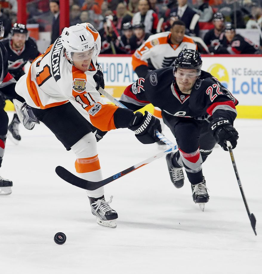 Philadelphia Flyers' Travis Konecny (11) breaks his stick shooting the puck in front of a lunging Carolina Hurricanes' Brett Pesce (22) during the first period of an NHL hockey game, Tuesday, Jan. 31, 2017, in Raleigh, N.C. (AP Photo/Karl B DeBlaker)