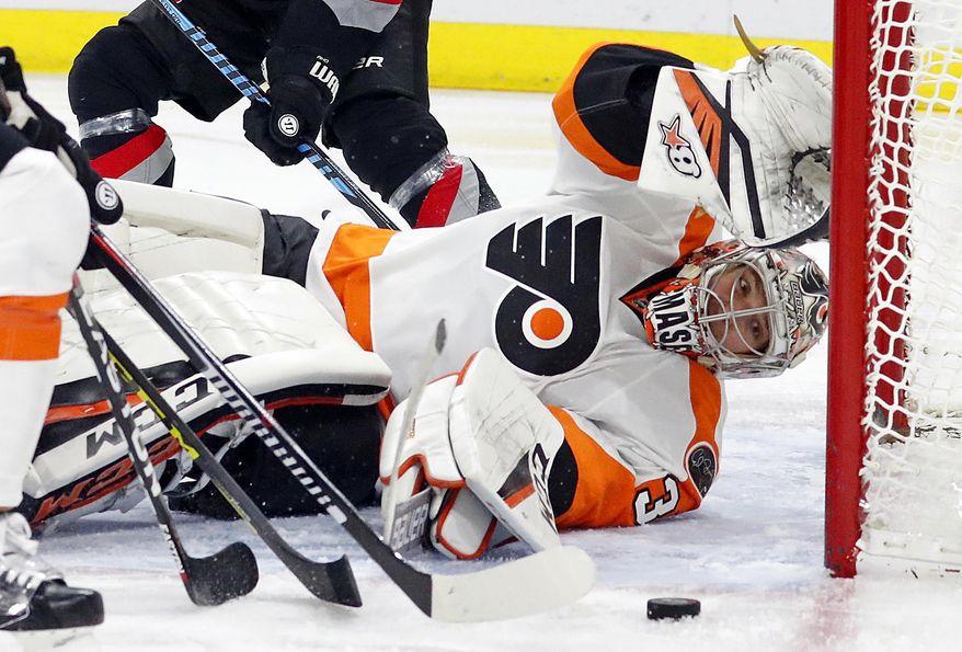 Philadelphia Flyers goalie Steve Mason (35) eyes the puck during the second period of an NHL hockey game against the Carolina Hurricanes, Tuesday, Jan. 31, 2017, in Raleigh, N.C. (AP Photo/Karl B DeBlaker)
