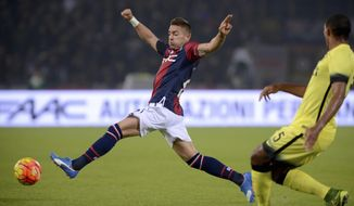FILE - In this Tuesday, Oct. 27, 2015 file photo, Bologna's Anthony Mounier tries to stop the ball during a Serie A soccer match between Bologna and Inter, at the Bologna Dall'Ara stadium, Italy. The attacking midfielder who signed a six-month loan deal with the French league club last week has returned to Italy without playing a ball after Saint-Etienne fans made it clear he was not welcome at Geoffroy Guichard stadium. (AP Photo/Gianfilippo Oggioni, File)