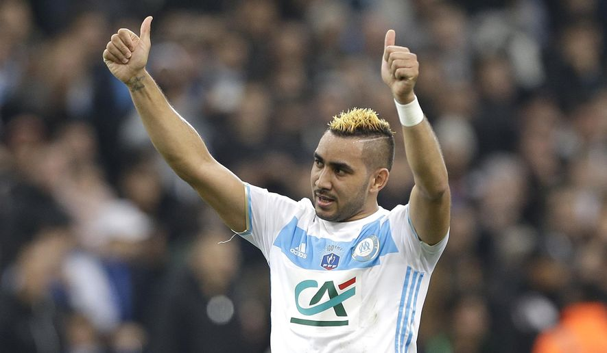 Marseille's forward Dimitri Payet,celebrates with supporters at the end of the French Cup soccer match between Marseille and Lyon, at the Velodrome Stadium, in Marseille, southern France, Tuesday, Jan.31, 2017. (AP Photo/Claude Paris)