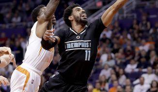 Memphis Grizzlies guard Mike Conley (11) shoots over Phoenix Suns guard Eric Bledsoe during the first half of an NBA basketball game, Monday, Jan. 30, 2017, in Phoenix. (AP Photo/Matt York)
