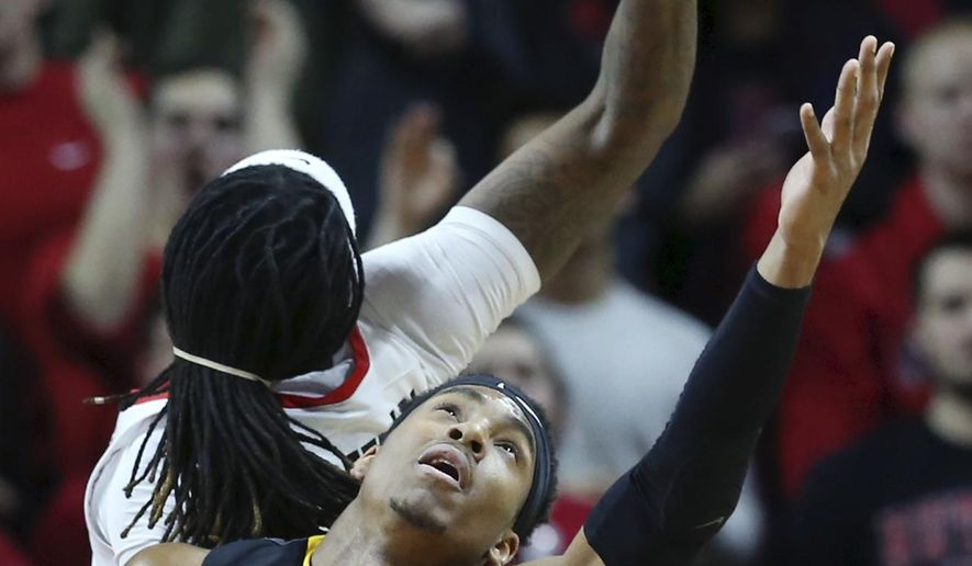 Rutgers forward Deshawn Freeman, back, leans backwards as Iowa forward Ahmad Wagner tries to control the ball during the first half of an NCAA college basketball game, Tuesday, Jan. 31, 2017, in Piscataway, N.J. (AP Photo/Mel Evans)