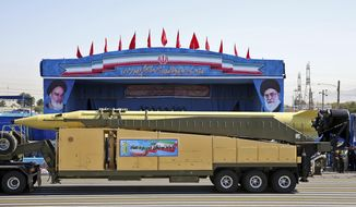 FILE -- In this Sept. 21, 2016 file photo, an Emad long-range ballistic surface-to-surface missile is displayed by the Revolutionary Guard during a military parade, in front of the shrine of late revolutionary founder Ayatollah Khomeini, just outside Tehran, Iran. At a joint news conference   Tuesday, Jan. 31, 2017 with his visiting French counterpart Jean-Marc Ayrault, Iranian Foreign Minister Mohammad Javad Zarif, refused to confirm that the country conducted a recent missile test, saying Iran's missile program is not part of a 2015 landmark nuclear deal between his country and world powers. (AP Photo/Ebrahim Noroozi, File)