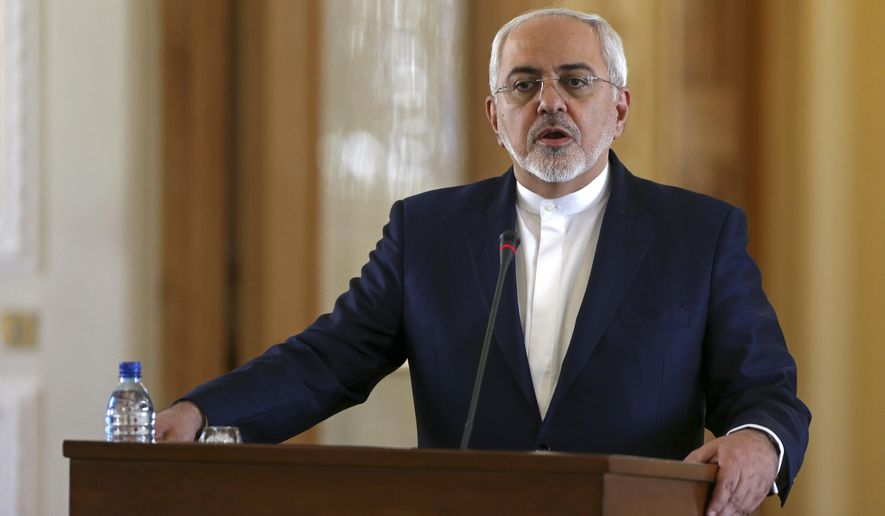 """Iranian Foreign Minister Mohammad Javad Zarif speaks at a joint press conference with his French counterpart Jean-Marc Ayrault, in Tehran, Iran, Tuesday, Jan. 31, 2017. At the press conference, Zarif refused to confirm that the country conducted a missile test, saying Iran's missile program is not part of a 2015 nuclear deal between his country and world powers. The White House said Monday it is studying the details of an Iranian ballistic missile test. A U.S. defense official said Monday that the missile test ended with a """"failed"""" re-entry into earth's atmosphere. (AP Photo/Vahid Salemi)"""