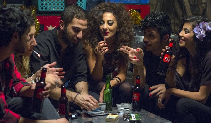 """This undated handout photo provided by Deux Beaux Garcon Films shows a scene from the movie """"In Between"""", the new award-winning film about Arab women battling their conservative society has touched off a real-life battle: the municipality of a major Arab city in Israel has called for a boycott of the film, and the film's director says she has received death threats for her unflinching portrayal of sex, drugs, parties, homosexuality and rape in her community. (Itay Gross, Deux Beaux Garcon Films via AP)"""