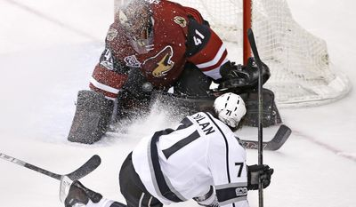 Los Angeles Kings center Jordan Nolan (71) sends the puck at Arizona Coyotes goalie Mike Smith (41) on a shot that would eventually end up in the net for a goal during the second period of an NHL hockey game, Tuesday, Jan. 31, 2017, in Glendale, Ariz. (AP Photo/Ross D. Franklin)