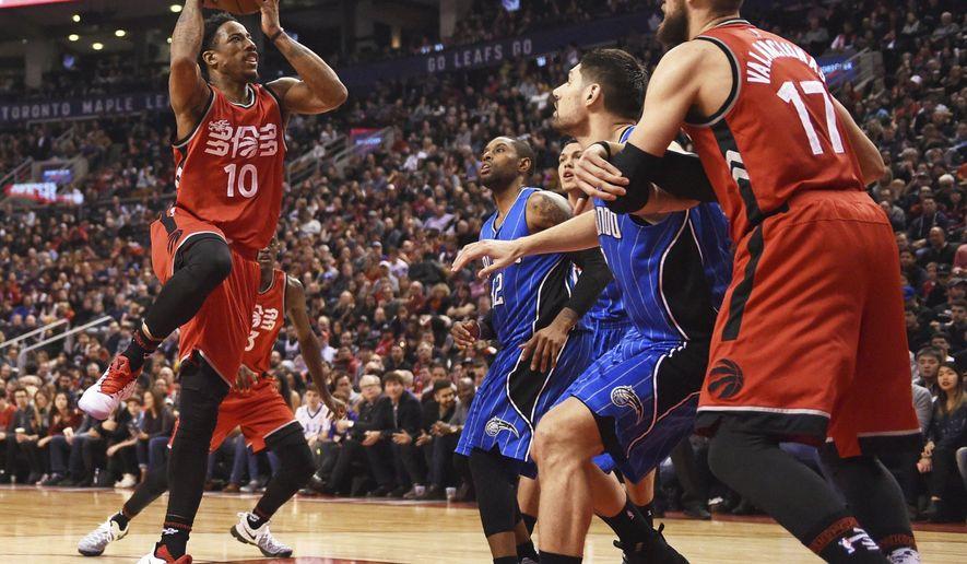 Toronto Raptors guard DeMar DeRozan (10) drives to the net against the Orlando Magic during first-half NBA basketball game action in Toronto, Sunday, Jan. 29, 2017. (Frank Gunn/The Canadian Press via AP)