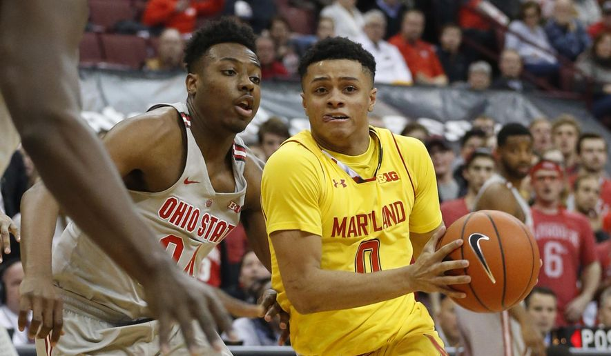 Maryland's Anthony Cowan, right, drives the lane against Ohio State's Andre Wesson during the first half of an NCAA college basketball game, Tuesday, Jan. 31, 2017, in Columbus, Ohio. (AP Photo/Jay LaPrete)