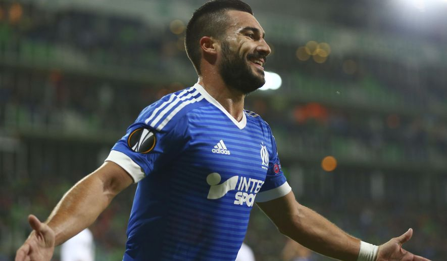 FILE - This Sept. 17, 2015 file photo shows Marseille's Romain Alessandrini celebrating scoring his side's third goal during the Europe League Group F soccer match between Groningen and Olympique Marseille at the Euroborg stadium in Groningen, northern Netherlands. Alessandrini has joined the LA Galaxy as their latest designated player. The Galaxy announced the deal Tuesday, Jan. 31, 2017. (AP Photo/Peter Dejong, file)