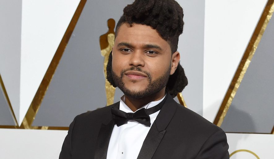 FILE - In this Feb. 28, 2016 file photo, The Weeknd arrives at the Oscars in Los Angeles. The Weeknd will team up for a performance with Daft Punk at the Grammy Awards on Feb. 12, 2017. The collaboration between the singer and the electronic music duo is one of a number of pairings announced Tuesday, Jan. 31, 2017. (Photo by Dan Steinberg/Invision/AP, File)