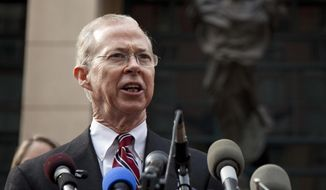 In this Jan. 26, 2012, file photo, Dana Boente, first assistant U.S. attorney for the Eastern District of Virginia, speaks outside federal court in Alexandria, Va. (AP Photo/Evan Vucci, File)