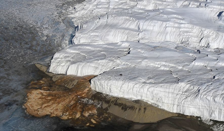 FILE - This Nov. 11, 2016 file photo shows Blood Falls, bottom left, and the Taylor Glacier near McMurdo Station, Antarctica. A Dutch tourist aboard a cruise ship near Antarctica who suffered a suspected stroke was successfully evacuated Tuesday, Jan. 31, 2017, to the U.S. base on the frozen continent. New Zealand's Rescue Coordination Centre said the 66-year-old woman was flown by the ship's helicopter to McMurdo Station and is due fly to New Zealand on Wednesday where she will receive further medical treatment. (Mark Ralston/Pool Photo via AP, File)