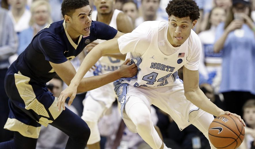North Carolina's Justin Jackson (44) dribbles while Pittsburgh's Cameron Johnson defends during the second half of an NCAA college basketball game in Chapel Hill, N.C., Tuesday, Jan. 31, 2017. North Carolina won 80-78. (AP Photo/Gerry Broome)