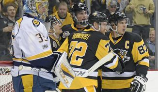 Pittsburgh Penguins right wing Patric Hornqvist (72) is congratulated by center Sidney Crosby (87) after scoring a goal as Nashville Predators goalie Pekka Rinne (35) waits for play to resume during the second period of an NHL hockey game Tuesday, Jan. 31, 2017, in Pittsburgh. (AP Photo/Fred Vuich)