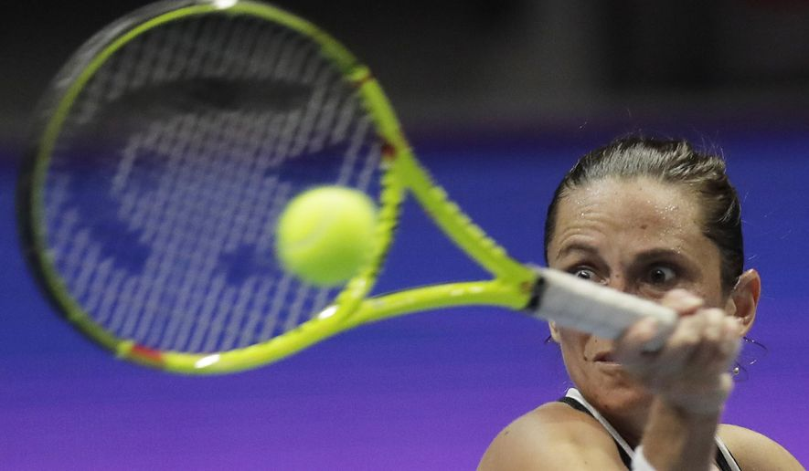 Roberta Vinci of Italy returns the ball to Timea Babos of Hungary during the St. Petersburg Ladies Trophy-2017 tennis tournament final match in St. Petersburg, Russia, Tuesday, Jan. 31, 2017. (AP Photo/Dmitri Lovetsky)