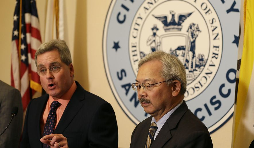 """San Francisco Mayor Ed Lee, right, listens as City Attorney Dennis Herrera, left, answer s questions about a lawsuit against President Donald Trump during a news conference at City Hall Tuesday, Jan. 31, 2017, in San Francisco. San Francisco sued President Donald Trump on Tuesday, claiming an executive order that cuts funding from immigrant-protecting """"sanctuary cities"""" is unconstitutional and a """"severe invasion of San Francisco's sovereignty."""" The federal government cannot """"put a gun to the head of localities,"""" City Attorney Dennis Herrera said, arguing that the order violates states' rights and the law. (AP Photo/Eric Risberg)"""