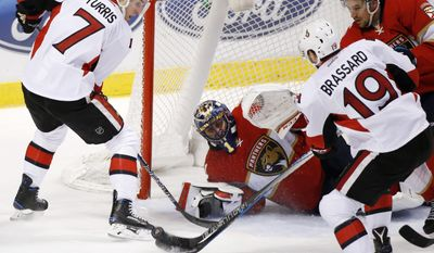Ottawa Senators center Derick Brassard (19) attempts a shot at Florida Panthers goalie Roberto Luongo (1) as center Kyle Turris (7) watches during the second period of an NHL hockey game, Tuesday, Jan. 31, 2017, in Sunrise, Fla. (AP Photo/Wilfredo Lee)