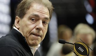FILE - In this Jan. 7, 2017, file photo, Alabama head coach Nick Saban answers questions during media day for the NCAA college football playoff championship game against Clemson in Tampa, Fla.  Alabama has a chance to sign one of the top classes in recent recruiting history and Ohio State isn't far behind as high school senior football players across the country make their college decisions official in a Signing Day that doesn't feature as much suspense as usual.(AP Photo/David J. Phillip, File)