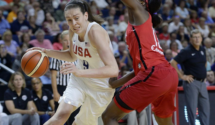 In this July 29, 2016, photo, United States' Breanna Stewart, left, dribbles around Canada's Tamara Tatham during the second half of women's exhibition basketball game in Bridgeport, Conn. Stewart didn't think twice about heading to LAX airport on Sunday, Jan. 29, 2017, to join the protest against the Trump administration's immigration ban. So the WNBA Rookie of the Year, who was in Los Angeles rehabbing a knee injury, was one of the 1,000s of people at the airport. (AP Photo/Jessica Hill)