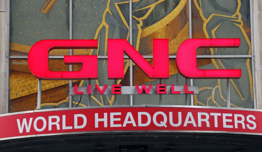 This Thursday, Jan. 12, 2017, photo shows a sign at GNC's world headquarters in Pittsburgh. GNC said Tuesday, Jan. 31, 2017, that it was notified that it will not be allowed to air its Super Bowl ad or any ad during Super Bowl 51 on Sunday, Feb. 5, because it violates an NFL policy against having supplements advertised during its games. (AP Photo/Gene J. Puskar)