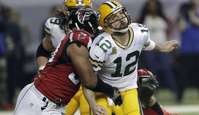 FILE - In this Jan. 22, 2017, file photo, Atlanta Falcons defensive end Dwight Freeney (93) hits Green Bay Packers' Aaron Rodgers after throwing a pass during the second half of the NFL football NFC championship game in Atlanta. Once the season is over, Freeney will think about his future. With his 37th birthday just weeks away, he knows time is running short. But if this is to be his final game, what a way to go out. (AP Photo/David J. Phillip, File)
