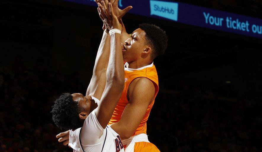 Tennessee forward Grant Williams (2) shoots against Auburn's Austin Wiley in the first half of their NCAA college basketball game on Tuesday, Jan. 31, 2017 in Auburn, Ala. (Todd J. Van Emst/Opelika-Auburn News via AP)