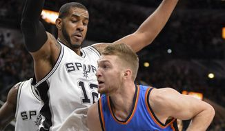 Oklahoma City Thunder forward Domantas Sabonis (3) attempts to shoot as he is defended by San Antonio Spurs forward LaMarcus Aldridge during the first half of an NBA basketball game, Tuesday, Jan. 31, 2017, in San Antonio. (AP Photo/Darren Abate)