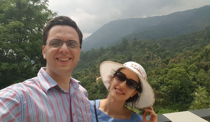 In this photo taken April 10, 2016 and provided by Dr. Omid Moghimi, Dr. Omid Moghimi and his wife, Dorsa Razi pose during their honeymoon in Munnar, Kerala State, India. President Donald Trump's order barring travelers from seven Muslim majority nations from entering the United States has created uncertainty for the newlyweds. Moghimi, a U.S. citizen and internist in New Hampshire, married Razi in Iran. She faced her visa interview this week to come to the United States, but that was abruptly canceled when the order took effect. Moghimi fears it could become permanent. (Dr. Omid Moghimi via AP)