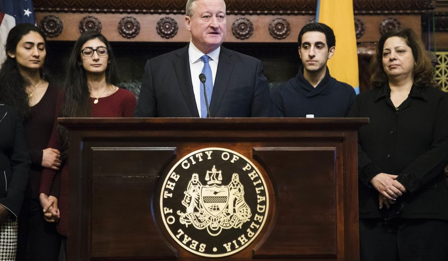 Philadelphia Mayor Jim Kenney, accompanied by Farzaneh Ahmadi Darani, left, and her sister Shadi Ahmadi Darani, along with Joseph Assali, center right, and his mother Sarmad Assali, speaks during a news conference at City Hall in Philadelphia, Tuesday, Jan. 31, 2017. Family members of both the Ahmadi Darani's and Assali's were denied entry into the United States at the Philadelphia airport over the weekend due to President Donald Trump's temporary ban on immigrants from seven Muslim-majority nations. A lawsuit has been filed against the Trump administration on behalf of the Syrian family. (AP Photo/Matt Rourke)
